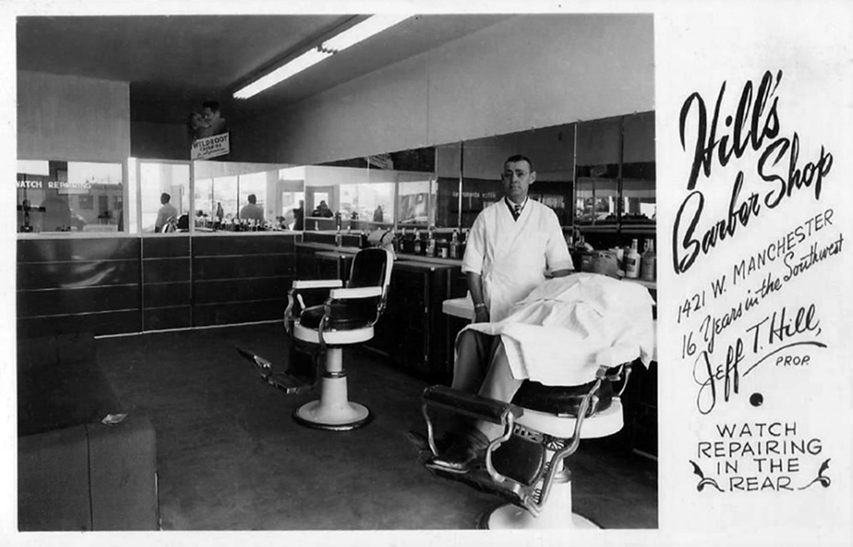 Hill's Barber Shop at 1421 W. Manchester, probably in the 1950s. In the back of the room, there is a sign for Wildroot Cream Oil, and if you look closely, you'll see the photographer's reflection in the middle of the photo. (Bizarre Los Angeles)
