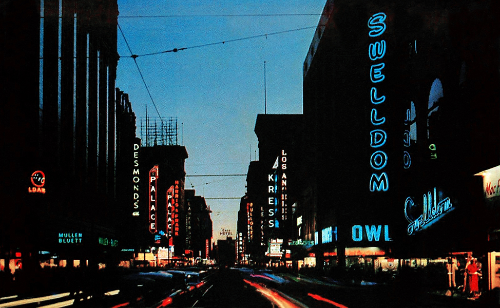 A postcard view of Broadway and 6th at dusk, circa 1960s. (Bizarre Los Angeles)