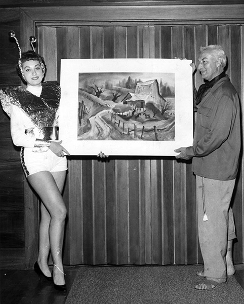 "In November 1959, Mary Audio,""Most Beautiful"" at the Beaux Arts Ball of Verdugo Hills Art Association, receives a painting by Ralph Hulett, well-known background artist for the Walt Disney Company. The other person in the photo is Will Turner. (LAPL) Bizarre Los Angeles"
