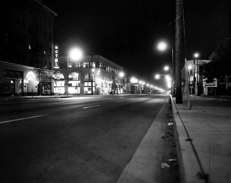 Figueroa Street and Exposition Blvd. on a Saturday night in 1966, back when the city tried enforcing 9:00 p.m. curfews to curtail crime.