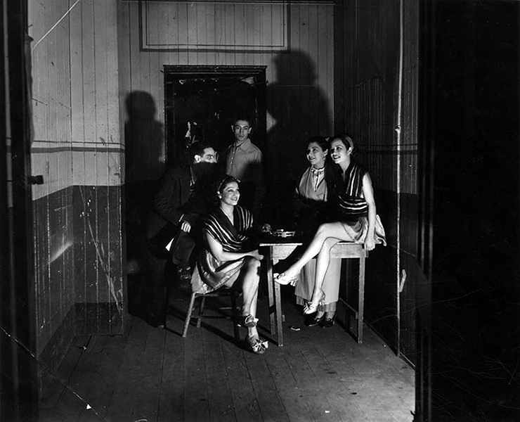 Members of El Teatro Mexico in 1936, hanging out in the Childs Grand Opera House's green room, where Sarah Bernhardt once waited to go onstage in 1891. The photo was taken on April 8, three days after the 1884 theater building closed. Once located at 110 S. Main St., it was quickly torn down to make a parking lot. (LAPL 00036861)