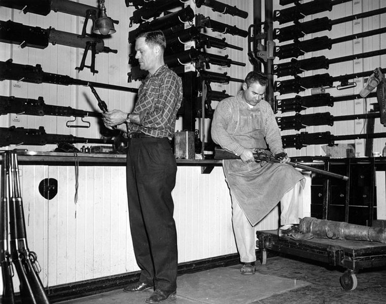 Edward Stembridge and gun technician Bob Lane inside the Stembridge gun room at Paramount Studios. The company supplied weapons to movie and TV productions. Photo dated February 5, 1960. (Bizarre Los Angeles)