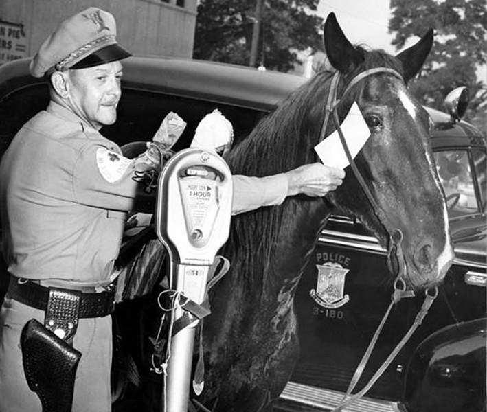 Officer Roy E. Armstrong issues a parking ticket in Glendale, circa 1949. (California State University, Northridge) Bizarre Los Angeles