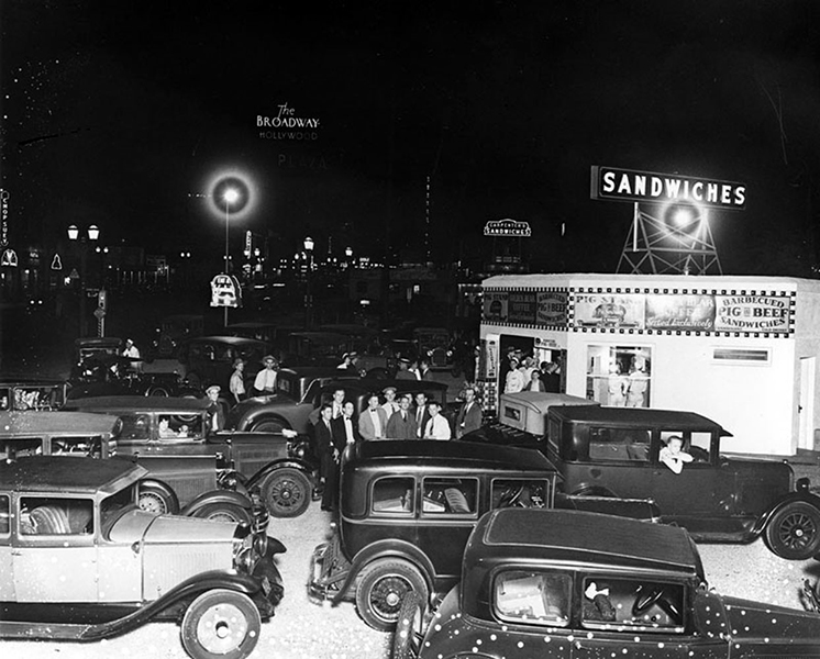 The Pig Stand, a brand new drive-in restaurant in 1930. Originally, it was located on the southeast corner of Sunset and Vine. However, according to the 1932 City Directory, it was no longer there. Instead, the directory listed additional Pig Stands in other locations around Los Angeles, including Los Feliz Blvd, La Brea, Pico, Vermont and Sunset, etc. (Bizarre Los Angeles)