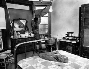 """A Los Angeles skid row hotel room in 1955. (LAPL) Note: According to the L.A. Times, right around the time this photo was taken, """"skid row"""" was the Bunker Hill area. (Bizarre Los Angeles)"""