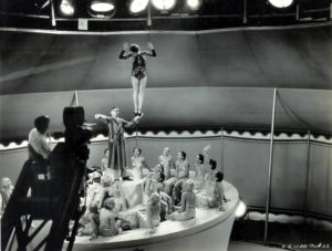 Cinematographer Gregg Toland sits next to the camera as Eddie Cantor and the Goldwyn Girls rehearse a musical number for Strike Me Pink (1936). The dancer in black is Dona Drake. (Bizarre Los Angeles)