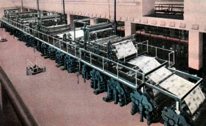 The Los Angeles Times' Hoe Super Production press consisting of 18 units in a line, which allowed for a new style of color printing in their daily newspapers. These machines were designed to print over 200,000 32-page newspapers in one hour. Postcard circa 1930. (Bizarre Los Angeles)