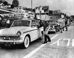 A holiday traffic check by California Highway Patrol officers on Sunset Blvd. near Sunset Plaza in 1965. (LAPL 00044613)