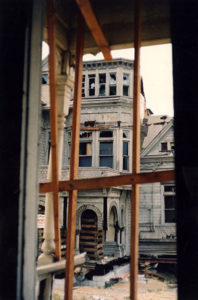 """Here is the """"Castle,"""" a rundown Queen Anne revival mansion built in 1882, after it was moved from 325 S. Bunker Hill Avenue to Montecito Heights for the newly created Heritage Square Museum in March, 1969. Before it could be restored, the house was destroyed by a fire later that year. The alleged arsonists were thought to have been teenagers/young adults who had used the mansion as a party house. The photo was taken from inside the Salt Box, another historic structure destroyed by the same fire. (LAPL 00102757) Bizarre Los Angeles"""