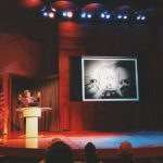 Craig Owens addresses a large crowd at the Los Angeles Public Library's Mark Taper Auditorium. (Bizarre Los Angeles)