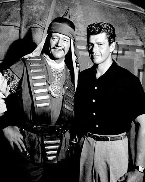 "John Wayne and Gordon Scott on the set of ""The Conquerors"" (1955). Bizarre Los Angeles"