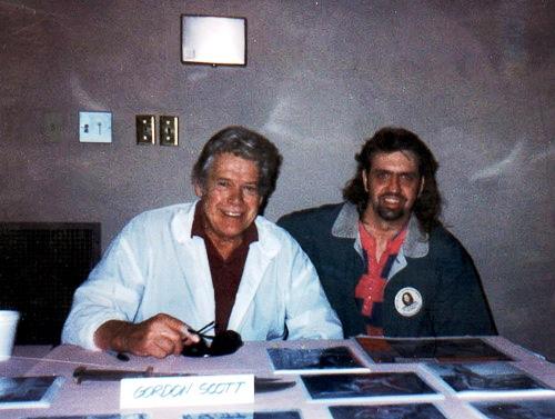 Tarzan actor Gordon Scott poses with a fan, c. 1995.