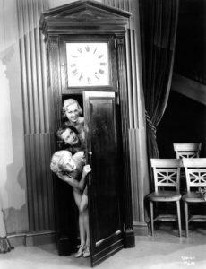 Chorus Girls hiding in a grandfather clock. (Bizarre Los Angeles)